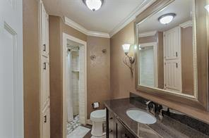 You will be amazed at the details this bathroom offer.  Full tiled shower with stone flooring, designer lighting, furniture vanity, even more storage and framed mirror are just a few of the features.