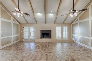 Your Main Living area is huge.  With all the picture frame wall detail, peak ceiling with wood detail, lovely gas logged fireplace and access to the back yard.