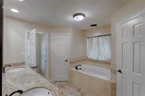 Your spa like master bath has a spa like deep soaking tub, his and her closets and sinks.  Wait till you see the shower.