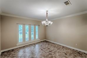 Entertain your family, friends or just a quiet dinner in your lovely Formal Dining Room.