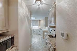 The Butlers Pantry is located directly off the Formal Dining Room and Kitchen.  Private sink allows you extra prep area.