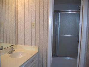 Master bath features two sinks in separate areas.