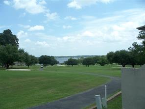 View of golf course & lake in the distance.