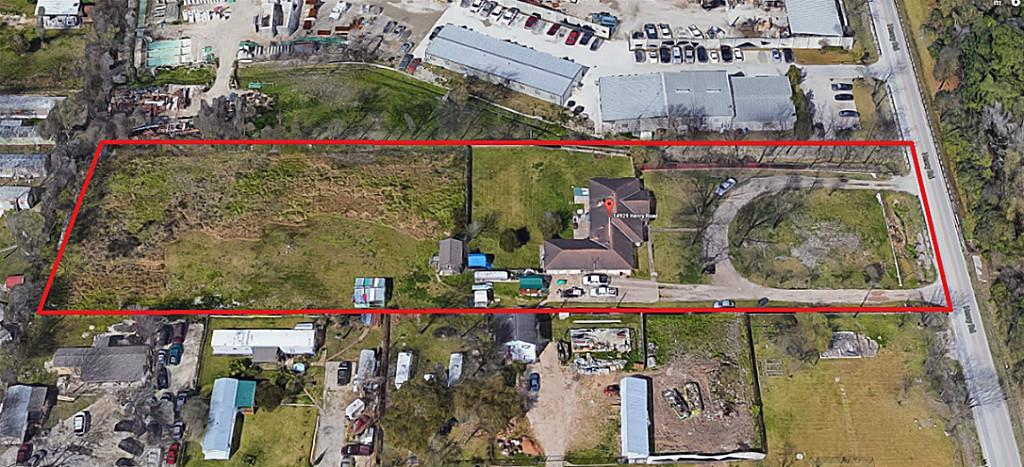 OVER 2.3 ACRES LOT - level ground – in UNRESTRICTED area near Hardy Toll Road, I-45, and Beltway 8.  There is a 3-Bedroom Brick Residence with Office and other income-producing structures onsite.  GREAT LOCATION in mixed use area that is in HARRIS COUNTY but not in City of Houston.  There is a PRIVATE WATER WELL.  Many other LIGHT INDUSTRIAL businesses nearby.  Great opportunity for entrepreneur who wants to live onsite and run a privately-owned construction type business.  PLENTY OF SPACE FOR PARKING VEHICLES AND EQUIPMENT.  Seller will consider all offers.  Please make an appointment.