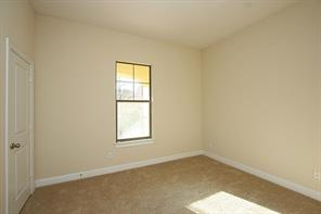 Second bedroom, located on the first floor off kitchen. Features plush carpeting, neutral paint and good size closet.