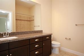 Second bath on the first floor, is shared with the second bedroom and your guests as powder room.