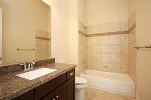 The fourth full bath is conveniently located between the fourth bedroom  and storage room.
