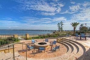 Great view of the lakeside amphitheater style fire pit. Not in picture is your outdoor dining area with barbeque grills. This property has exquisite style with the ambiance of a Spanish resort.