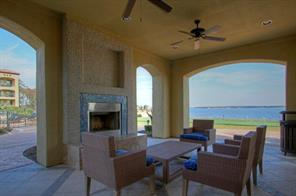 Clubhouse: covered patio lounge area with ceiling fans, wood burning fireplace & expansive lake views