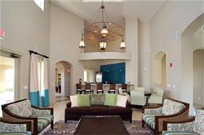 Clubhouse: Spacious entertainment room with TV, bar & refrigerator.