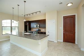 Granite counter-tops, custom cabinetry & stainless appliances complete this fabulous kitchen.