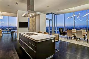New York? Not at all - its our beautiful city of Houston at dusk! Fill this dining table with friends and laughter - plenty of room for holiday gatherings in this over 4200' one story nineteenth floor beauty.