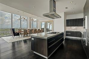 Banquet size dining room is enhanced by banks of windows imparting northwest views of the city.