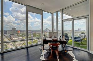 Gorgeous master bedroom has sweeping views afforded  by floor-to ceiling windows.  It has built-in surround sound speakers, recessed lighting and remote controlled blinds.