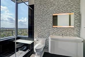 A wonderful sense of space is felt in the master bath as its intriguing clean lines enhance its beauty.
