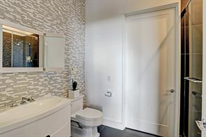Seamless doors showcase the superior finishes that were used in creating the remarkable shower.