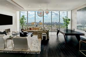 Cloaked in soothing gray designer wall covering, this room exudes warmth while it enjoys views of the city.