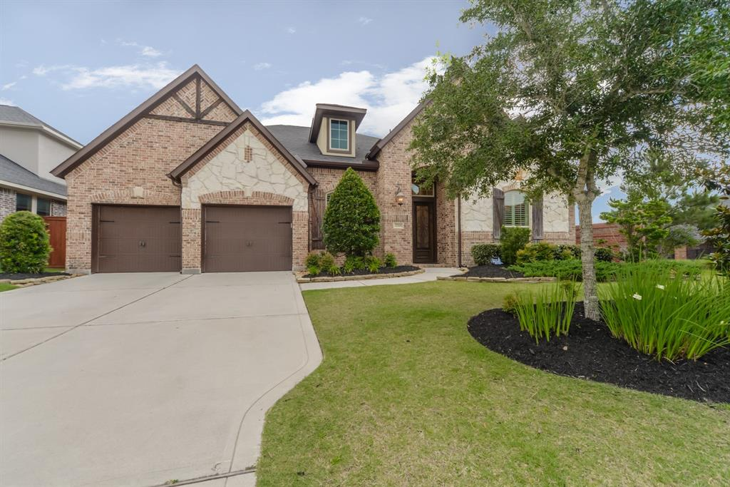 "RARE 1.5 story Trendmaker Home on CORNER LOT! The gated community of Benders Landing Estates has convenient access to downtown via Grand Pkwy (99) & Hardy Toll Road while providing a secluded, country setting. This ""barely lived-in"" home features popular wood-look tile in common areas, designer kitchen finishes w/exotic granite counters, sleek tile backsplash, stainless steel appliances, decorative, dark metal stairs w/wood handrails. An oversized island w/counter bar opens to living area-great for entertaining! Take entertaining upstairs to the game room w/half bath-a space w/endless possibilities! A leaded glass front door, tall foyer, bay windows in breakfast & Master bedroom are a few of the architectural details that add character. Rich cabinetry, exotic granite, split vanities, oversized frameless glass shower & deep soaking tub transform the spacious master bath into your own private spa. A covered patio w/OUTDOOR KITCHEN doubles livability factor! DOES NOT BACK TO RAYFORD RD!"