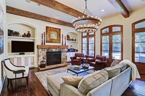 Family room - antique ceiling beams, gas log fireplace with stone surround and wood mantel.