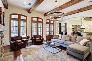 Family room - three sets of double doors with arched transom windows. Arched bookcases with lower cabinets.