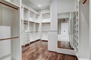 Master bath - groin-vaulted ceiling, double sinks with slab granite counter top, whirlpool tub with granite surround, shower with frameless glass door, marble tile floor.e