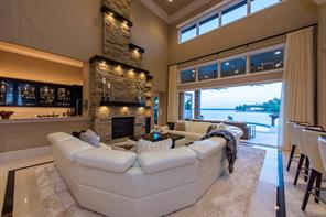 Large family room lies between wet bar/fireplace and kitchen and has a great lake view enhanced by wide-opening bi-fold doors.