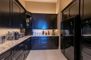 Working pantry with storage galore, extra refrigerator, second full-size oven and appliance garage.  Perfect for catering and party staging.