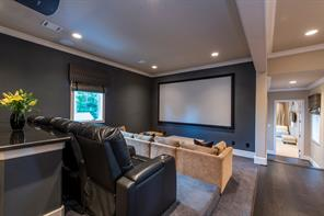 Media room has varied seating options with high bar for dining, theater seating and couch lounging. Can easily be converted to ensuite bedroom.