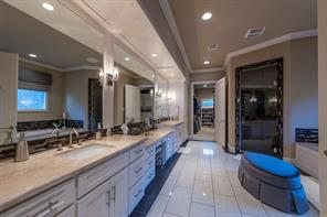 Luxurious master bath with coffee bar and refrigerator.