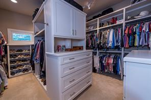 Large master closet provides uniquely efficient and varied storage options.
