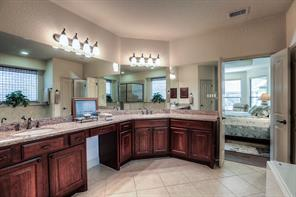 Master bathroom offers granite counters, vanity space, 2 sinks, tub and separate shower.