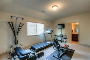 One of the bedrooms upstairs can be used as a workout room. This room has an attached bathroom that is convenient for the media and loft.