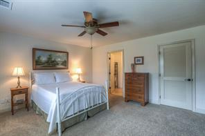 Main floor bedroom in guest house is very spacious with a full bathroom and walk-in closet.