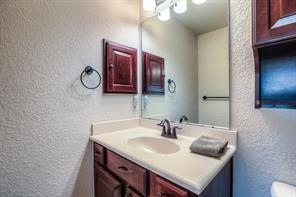 Full bathroom w/shower in one of the main floor masters. built-in linen and medicine cabinets.