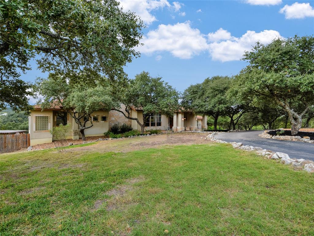 TWO separate Hill Country custom homes located on 3.68 acres! The arrangement on the property is perfectly designed for extended family stays, rental income or those who just love to entertain and host guest. Beautiful panoramic views from the screened upper balcony overlooking the inviting pool, waterfall and hot tub. The main home is 5686 sq ft with 3 car garage and 4 bedrooms/4 baths, and is connected by a breezeway to the second home featuring 1863 square feet,2 car garage,and 2 bedrooms/2 baths.  Each home offering it's own private garage and beautifully crafted glass front door entries.