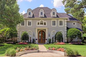 """Elegant French stucco residence in the gated/guarded Stablewood subdivision with premier corner location next to the three acre original """"Stable"""" estate."""
