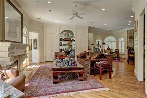 The spacious FAMIY ROOM (27 X 17) is centrally located between the Breakfast Room/Kitchen areas, the downstairs Utility Room corridor with half bath, doorways to the two home's two garages, back staircase to the Media Room, and doors to the outdoor patio/pool area.