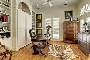 The STUDY (13 X 15) features oak flooring, built-in desk/bookshelves, crown/base molding, ceiling fan, shuttered windows with fan shaped windows above, double doors to backyard Hot Tub, built-in speakers and recessed lighting.