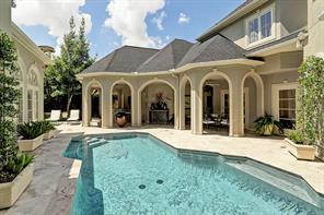 This great custom built family home includes a backyard beautifully finished with pool and water features, hot tub, covered outdoor seating and built-in bar.