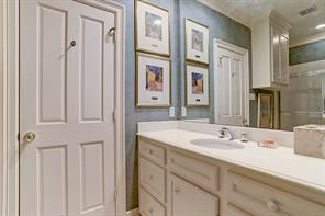 En Suite Bath to #4 Guest Bedroom/Guest Quarters include tile flooring, tub/shower with tile surround, painted cabinets, entrance to cedar closet and attic storage area.