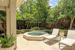 Just off the Master Study is the Hot Tub - tucked in a secluded area of the patio.  Lush landscaping surrounds the hot tub with its tile surround.