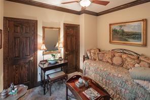 Master suite, tucked at the end of a hallway with an addition half bath, with raised ceilings, lovely views of the front yard