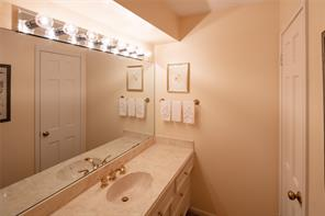 Upstairs Jack and Jill bath, with dual cultured marble vanities, and tub shower enclosure.