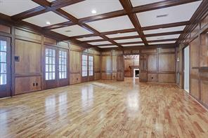Family room with hardwoods, doors to screened in porch and access to library.