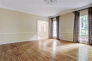 Banquet sized formal dining room, with hardwood floors, tall windows, chair rail and access to both foyer and kitchen.