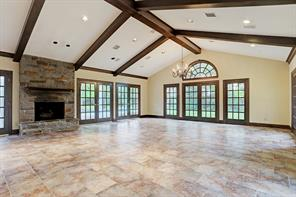 Formal living room, with hardwood floors, tall windows and access to the foyer.