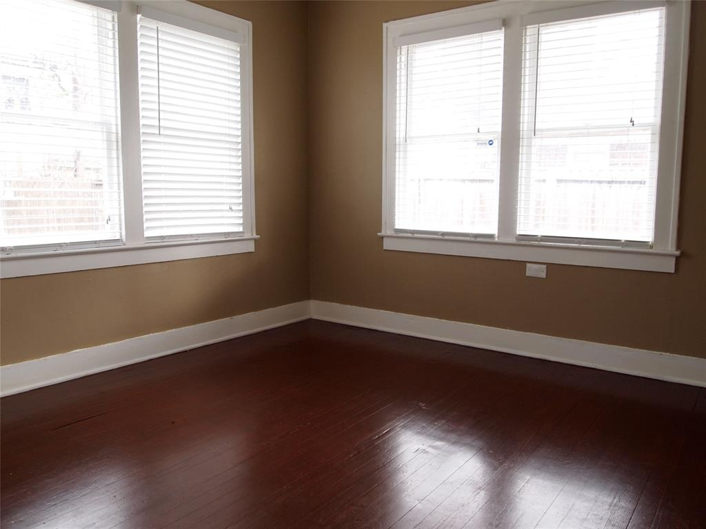 Bedroom # 2 with hardwood floors.