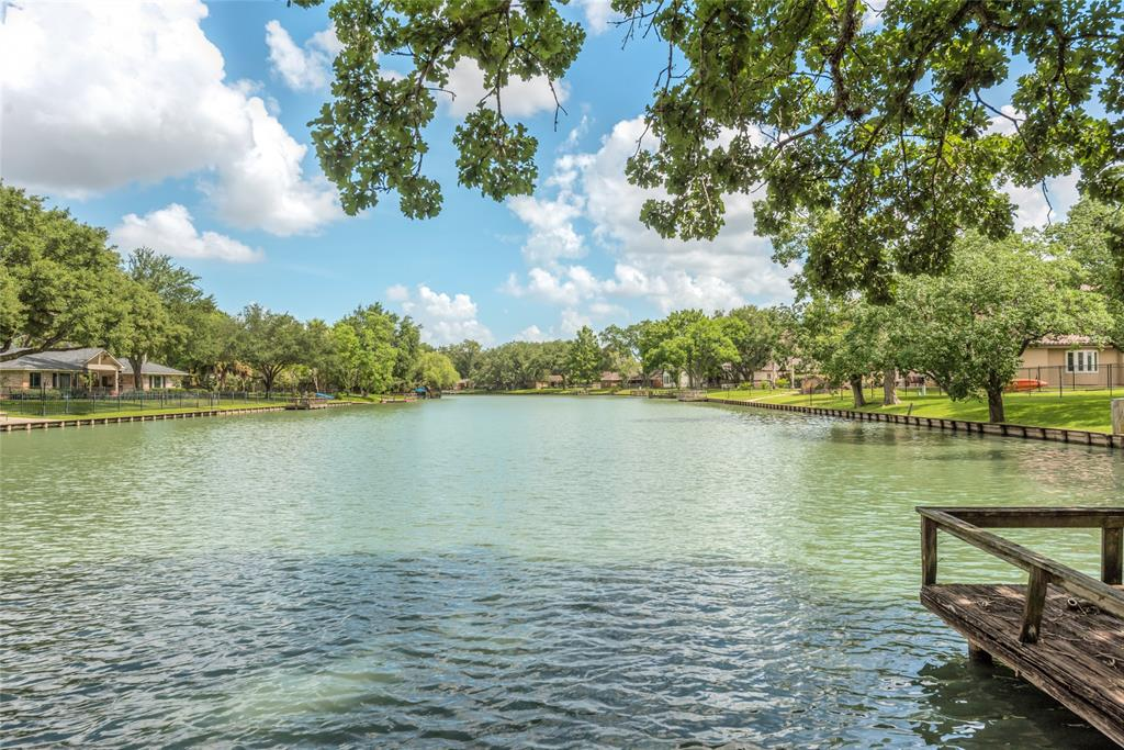 AWE-INSPIRING LAKEFRONT VIEW! Highly sought-after property in the one-of-a-kind lake community of Venetian Estates.  Established in 1959 as one of Sugar Land's premier neighborhoods this picturesque 1/2 ACRE LOT features mature sprawling oak trees. The property has an exceptional view down a long section of Lake Venice the 44 acre lake that winds through the community and is known for it's refreshing swimming and relaxing boating. Enjoy a sunset cruise or fish the stocked lake from your personal pier. The incomparable location offers prime access to popular dining, retail, entertainment, and the Houston metro area. Take advantage of The Fort Bend Children's Discovery Center, Imperial Farmer's Market as well as the widely popular Blendin Coffee Club, all within a walk or bike ride away. Call today to schedule a tour.