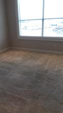 Carpet flooring in the bedroom. Also comes with blinds.
