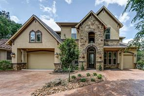 Wait until You See The Views!!  Full Masonry Stucco and Stone With 4 Car Garage!